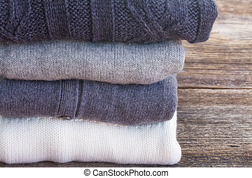 woolen clothes - folded woolen clothes close up on wooden...