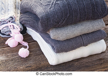 woolen clothes - stack of folded woolen gray and white ...