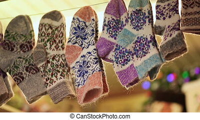 Woolen socks with patterns at the Christmas market on Red Square. Close-up. Russia. New Year theme.