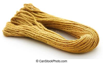 Woolen thread of golden