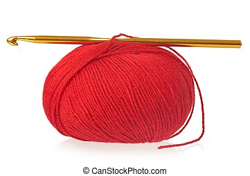 Woolen thread with crochet isolated over white background...