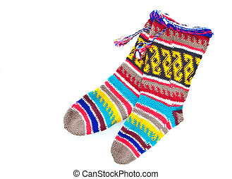 Pair of wonderfully vibrant woolen stockings as a cut out