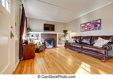 woonkamer, lederene sofa, tv., openhaard