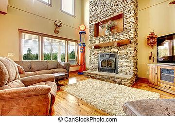 woonkamer, met, hoog, plafond, steen, openhaard, en, leder,...
