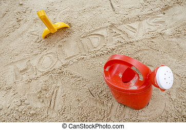 Wor holidays in sand with beach toys