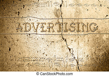 advertising - word advertising on wall with egyptian...