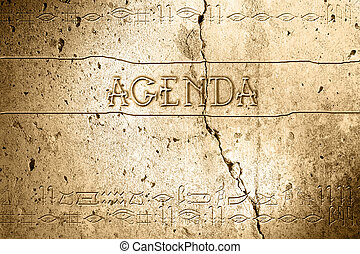 agenda - word agenda on wall with egyptian alphabet made in...