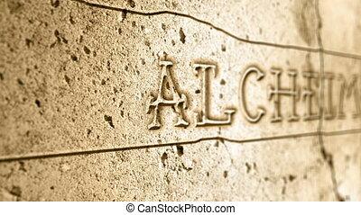 word alcheimer on wall with egyptian alphabet