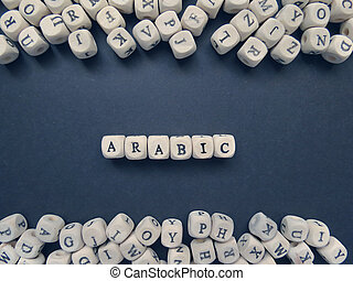 Word Arabic of small white cubes on a dark background