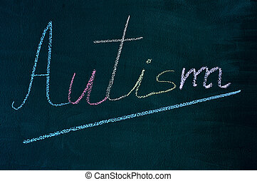 word autism written on a chalkboard