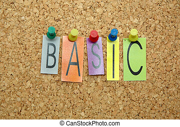 """Word """" Basic """" placed from colourful small letters on the cork board"""