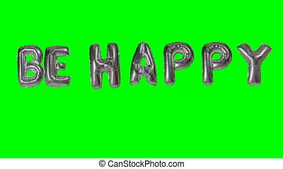 Word be happy from helium silver balloon letters floating on...