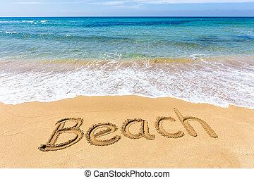 Word Beach written in sand at greek sea