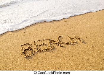Word beach written in the sand beach