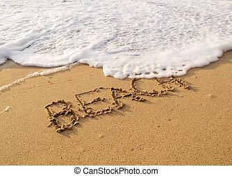 Word beach written in the sand on the beach
