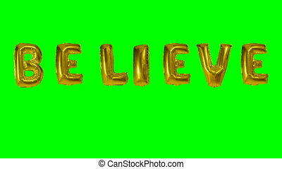 Word believe from helium gold balloon letters floating on...