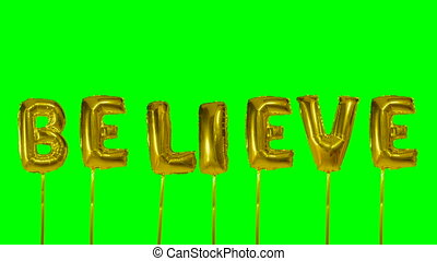 Word believe from helium golden balloon letters floating on...