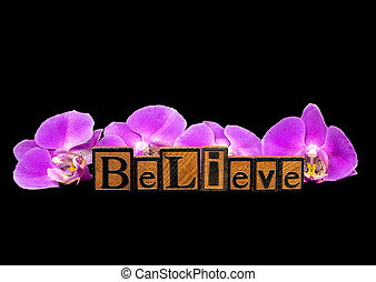 word believe letterpress type and orchid blossoms