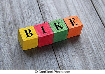 word bike on colorful wooden cubes