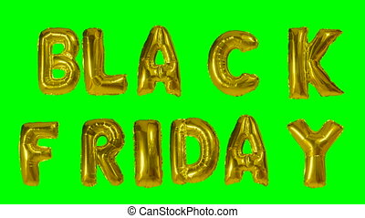Word black friday from helium gold balloon letters floating...