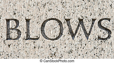 """Word """"Blows"""" Carved in Gray Granite Stone"""