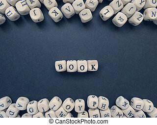 Word Book of small white cubes on a dark background