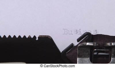 Word business plan printed on a retro typewriter. Close up -...