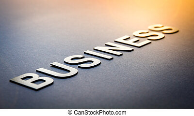 Word business written with white solid letters