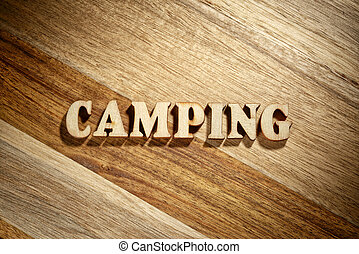 Word camping made with wooden letters