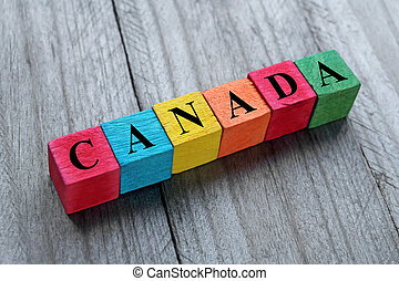 word Canada on colorful wooden cubes
