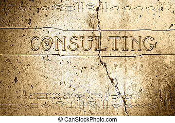 consulting - word consulting on wall with egyptian alphabet...