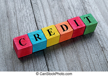 word credit on colorful wooden cubes