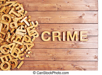 Word crime made with wooden letters