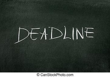 """Word """"Deadline"""" writed on blackboard with chalk"""