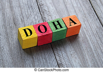 word Doha on colorful wooden cubes