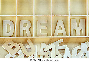 Word dream made with block wooden letters