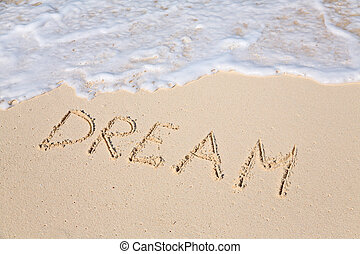 Word DREAM on beach - vacation concept background