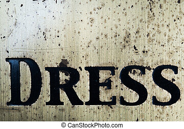 "Word ""dress"" in black letters"