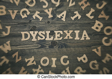 Word dyslexia on a wooden background