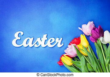 Word Easter and bouquet of flowers