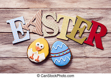 word easter and cookies decorated as easter egg and chick