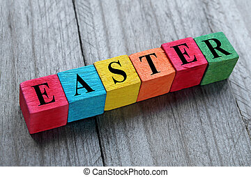 word easter on colorful wooden cubes