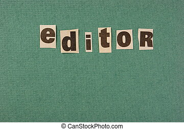 word editor cut from newspaper on green background