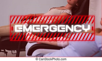 Word Emergency written over women sitting in background. - ...