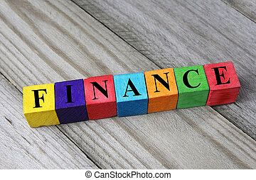 word finance on wooden cubes