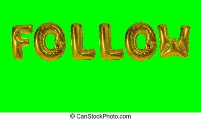 Word follow from helium gold balloon letters floating on...