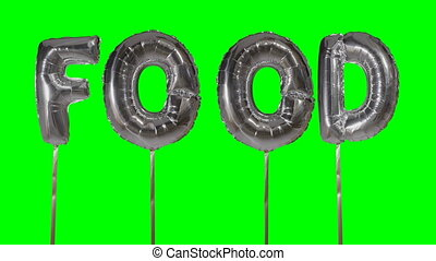 Word food from helium silver balloon letters floating on...