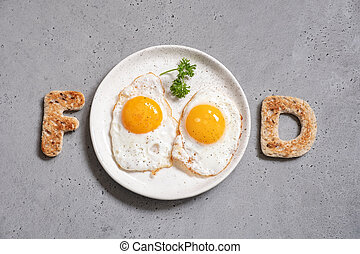 Word food written with toast letters eggs