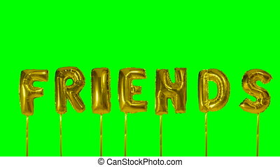 Word friends from helium golden balloon letters floating on...