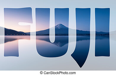 word FUJI transparent over mountain Fuji at dawn with peaceful lake reflection